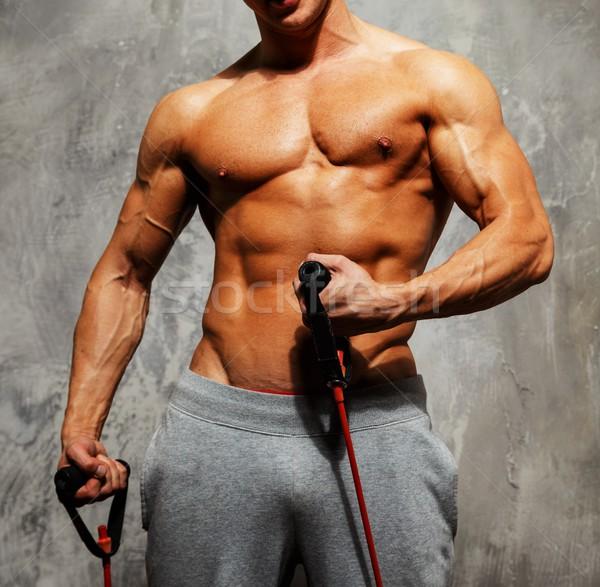 ハンサムな男 筋骨たくましい体 フィットネス 行使 ジム 筋 ストックフォト © Nejron