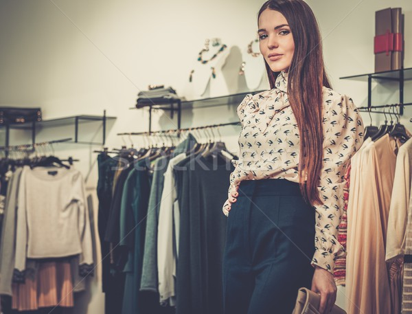 Fashionable young woman in a fashion showroom Stock photo © Nejron