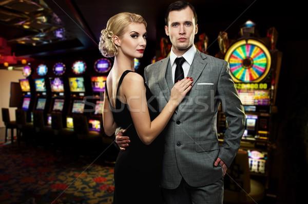 Retro couple against slot machines Stock photo © Nejron
