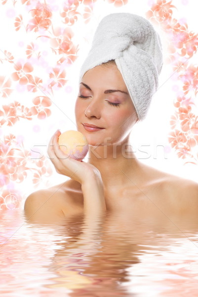 Beautiful girl with aroma bath ball reflected in rendered water Stock photo © Nejron