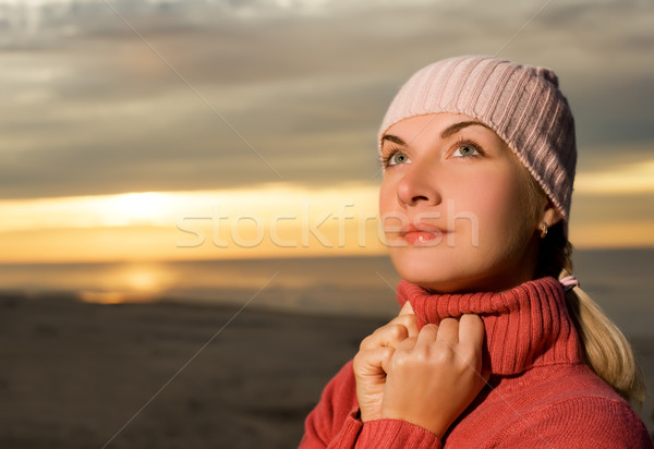 Beautiful woman on a beach at sunset Stock photo © Nejron