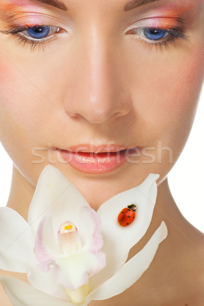 Close-up portrait of a beutiful girl with white orchid Stock photo © Nejron