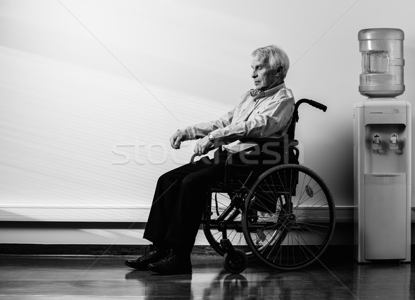 Thoughtful senior man in wheelchair in nursing home  Stock photo © Nejron