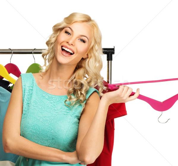 Sorridente loiro mulher escolher moda Foto stock © Nejron
