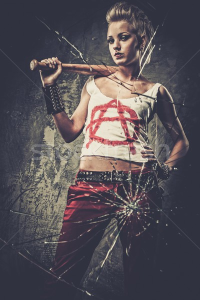 Punk girl behind broken glass with a baseball bat Stock photo © Nejron