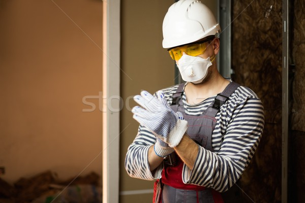 Builder in protective wear during new building construction  Stock photo © Nejron
