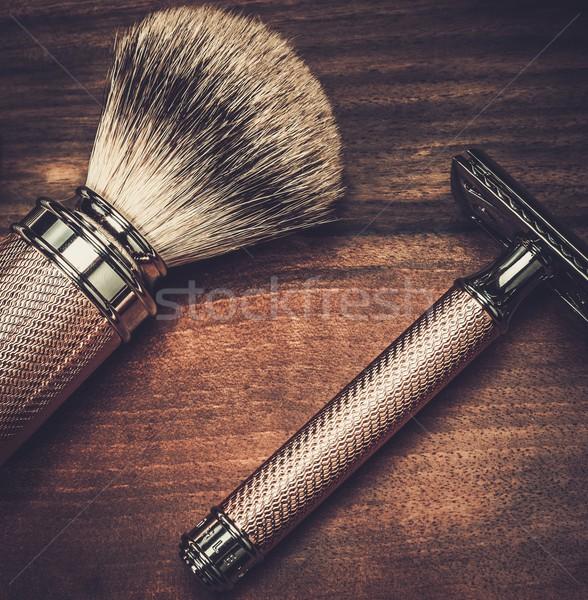 Safety razor and shaving brush on a wooden background  Stock photo © Nejron