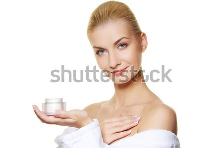 Woman applying moisturizer cream on her body Stock photo © Nejron