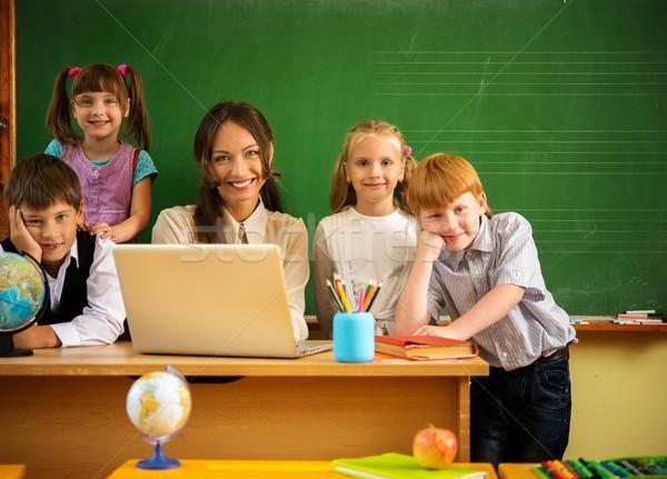 Csoport boldog osztálytársak tanár osztály iskolatábla Stock fotó © Nejron