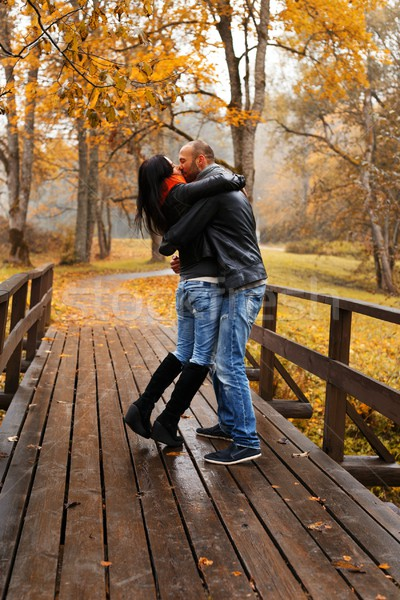 Happy middle-aged couple kissing outdoors on beautiful autumn day Stock photo © Nejron