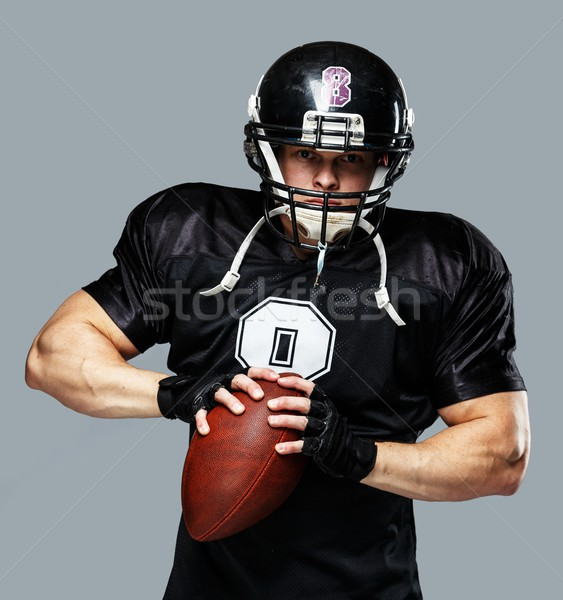 American football player with ball wearing helmet and jersey  Stock photo © Nejron