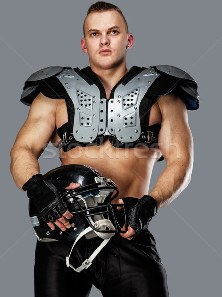 American football player with helmet and armour  Stock photo © Nejron