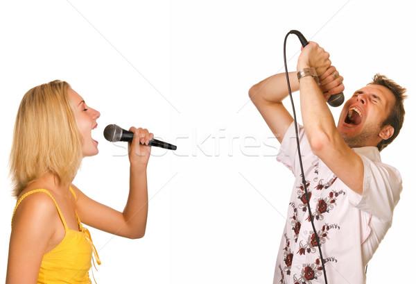Paar zingen karaoke geïsoleerd witte vrouw Stockfoto © Nejron