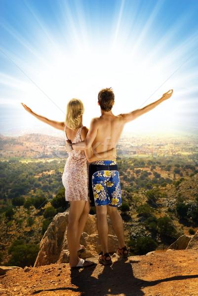 Atraente casal relaxante alto montanhas céu Foto stock © Nejron