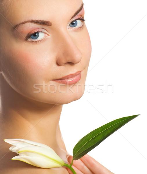 Beautiful girl with white lilly Stock photo © Nejron