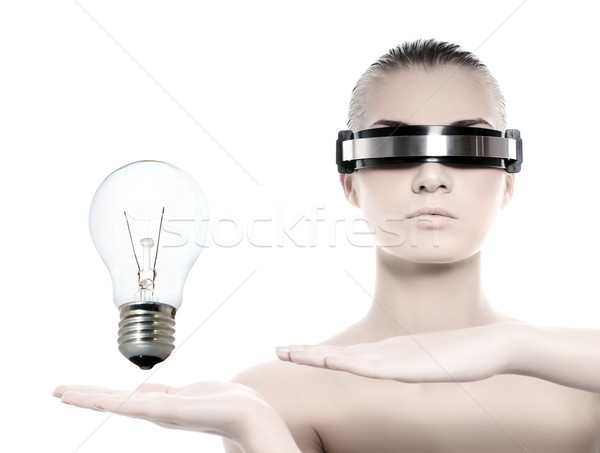 Beautiful cyber woman with a tungsten bulb isolated on white bac Stock photo © Nejron