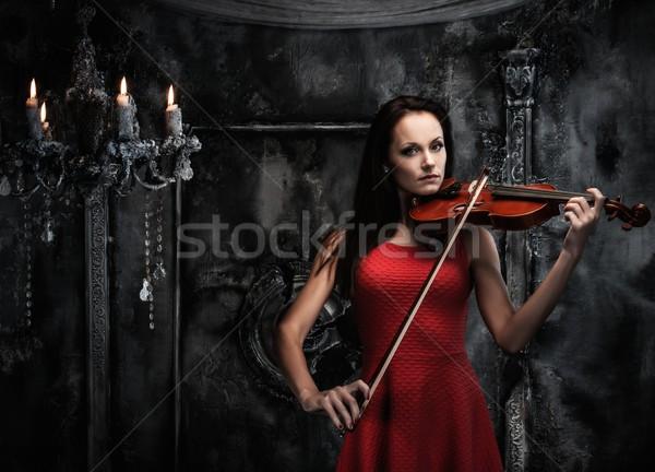 Vestito rosso giocare violino mistica interni Foto d'archivio © Nejron