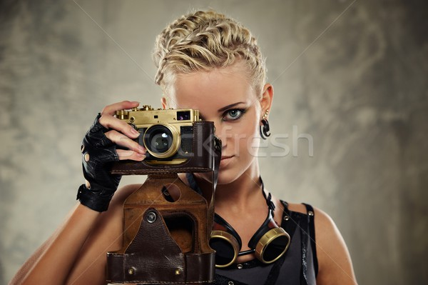 Close-up portrait of a steam punk girl with a photocamera Stock photo © Nejron