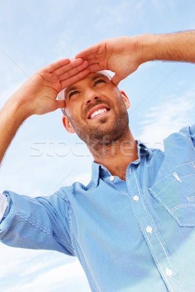 Positive middle-aged man outdoors against sky Stock photo © Nejron