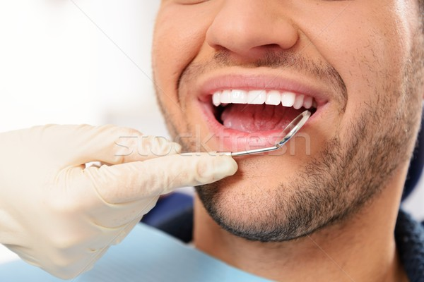 Man doing teeth checkup at dentist's surgery  Stock photo © Nejron