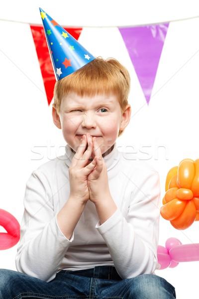 Little redhead boy in birthday paper hat Stock photo © Nejron