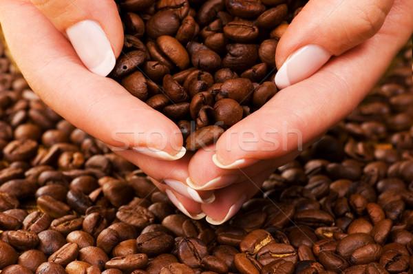 Handful of premium coffee beans Stock photo © Nejron