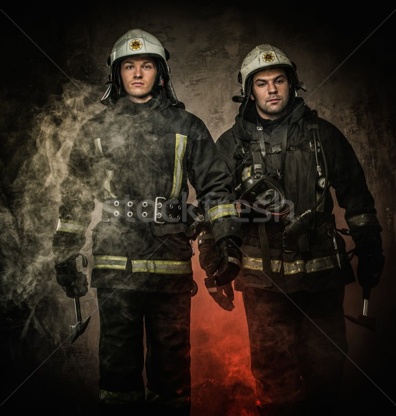 Two firefighters with helmet and axe in a smoke Stock photo © Nejron
