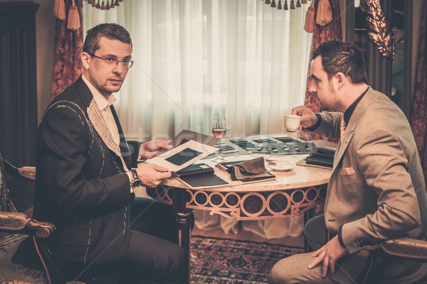 Tailor and client choosing cloth and buttons for custom made suit  Stock photo © Nejron