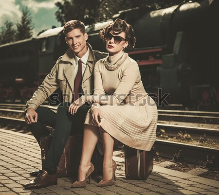 Vintage estilo malas estação de trem mulher Foto stock © Nejron
