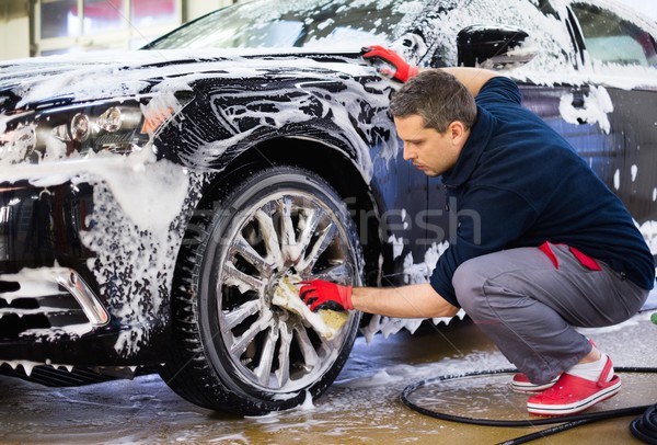 Man worker washing car's alloy wheels on a car wash  Stock photo © Nejron