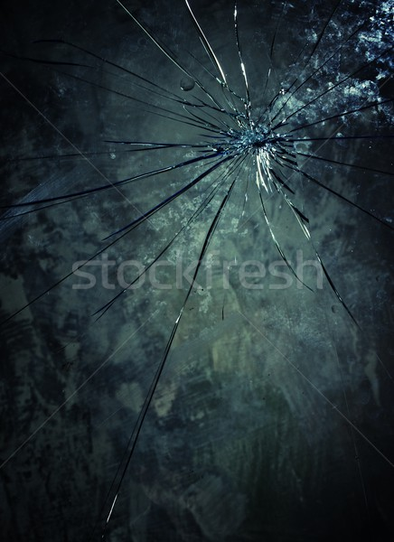 Broken glass over grey background. Stock photo © Nejron