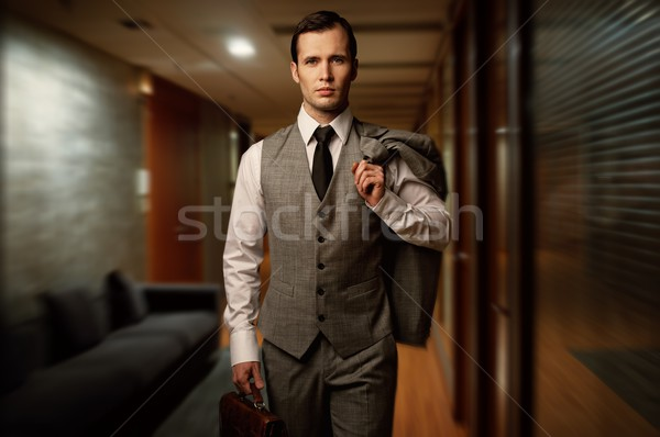 Man with a briefcase in a hotel hallway. Stock photo © Nejron