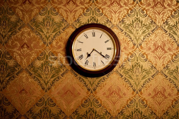 Stock photo: Vintage clock on a wall