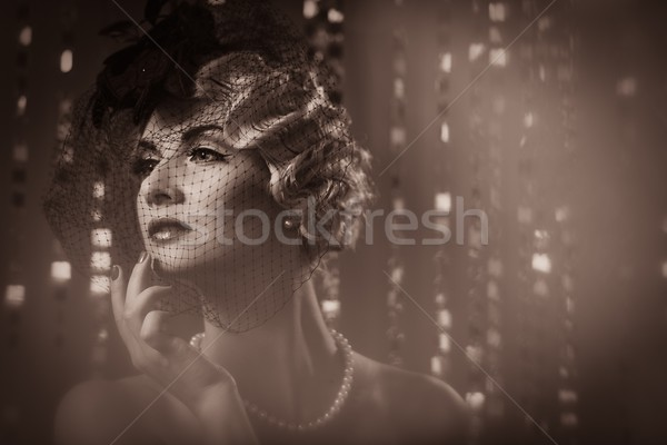 Toned picture of  elegant blond retro woman   wearing little hat with veil  Stock photo © Nejron