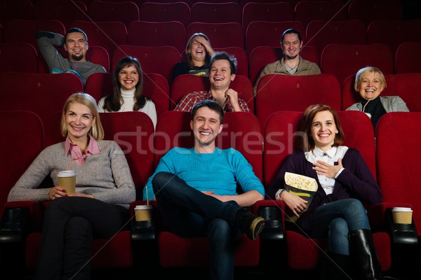 Group of young people watching movie in cinema Stock photo © Nejron