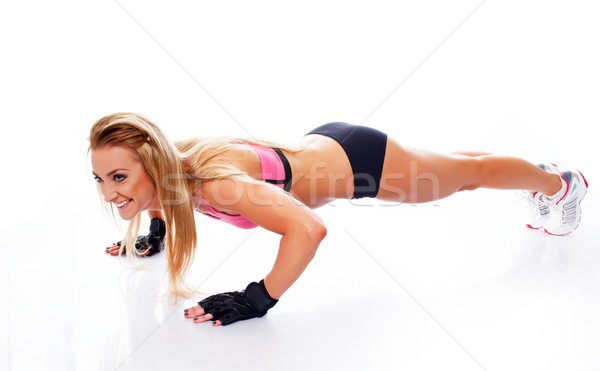 Sporty woman doing push-up on white background  Stock photo © Nejron