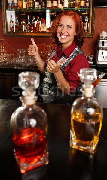 Beautiful redhead barmaid behind bar counter  Stock photo © Nejron