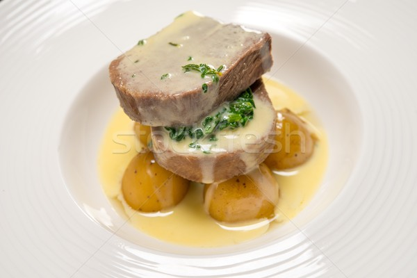 Stock photo: Two pieces of meat with potato and sauce