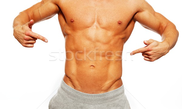 Sporty muscular man showing his abdominals Stock photo © Nejron