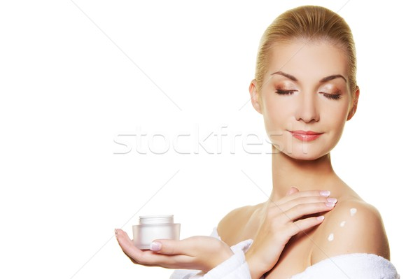 Woman applying moisturizer cream on ner body Stock photo © Nejron