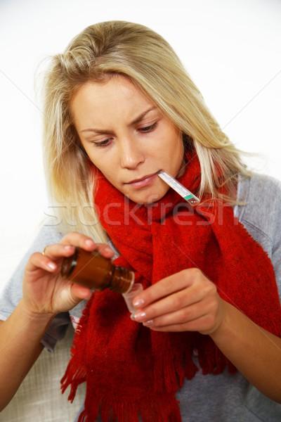 Doente jovem loiro mulher termômetro garrafa Foto stock © Nejron