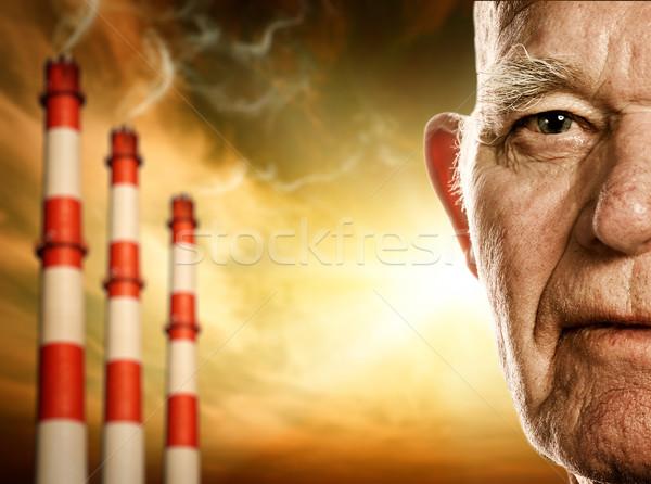 Elderly man's face. Power plants on background Stock photo © Nejron