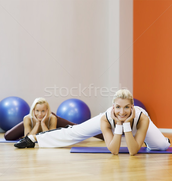 Stock photo: Group of people doing stretching exercise