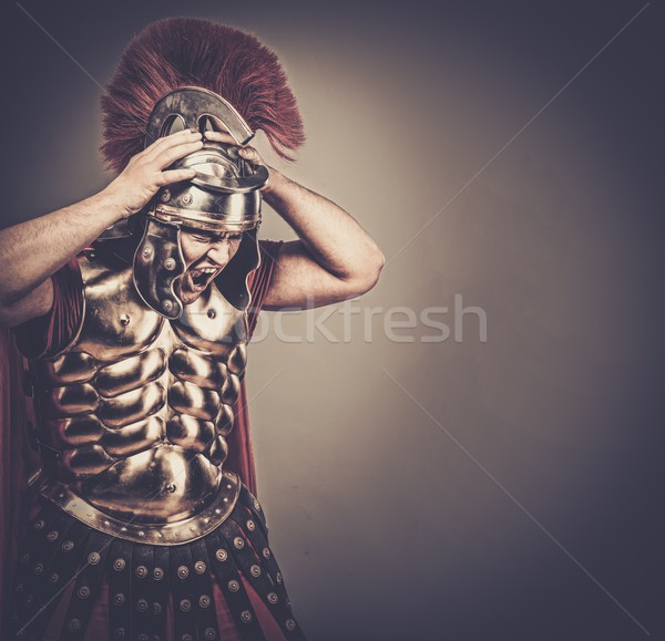 Stock photo: Angry legionary soldier in armour