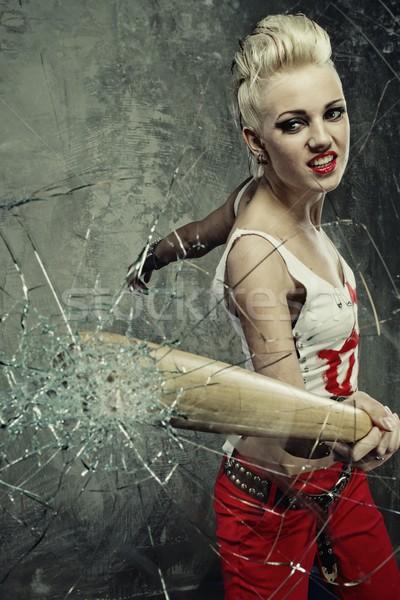 Punk girl broking a glass with a bat Stock photo © Nejron