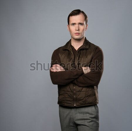 Man in vest isolated on grey background Stock photo © Nejron