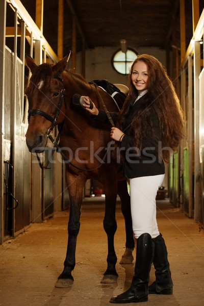 Beautiful girl with her horse in a stall  Stock photo © Nejron