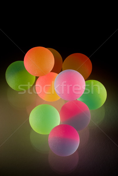 Stylish colorful balls with reflection. Isolated on black backgr Stock photo © Nejron
