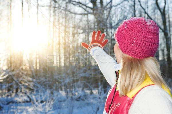 Fiatal nő integet viszlát tél erdő naplemente Stock fotó © Nejron