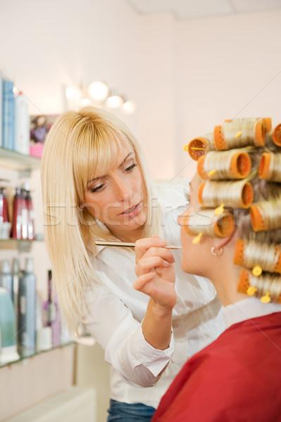 Female hairdresser working in beauty salon Stock photo © Nejron
